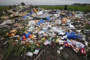 Flowers and mementos placed at the crash site of Malaysia Airlines Flight MH17 are pictured near the settlement of Rozspyne in the Donetsk region