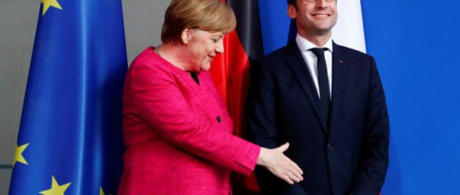 Ангела Меркель и Эммануэль Макрон